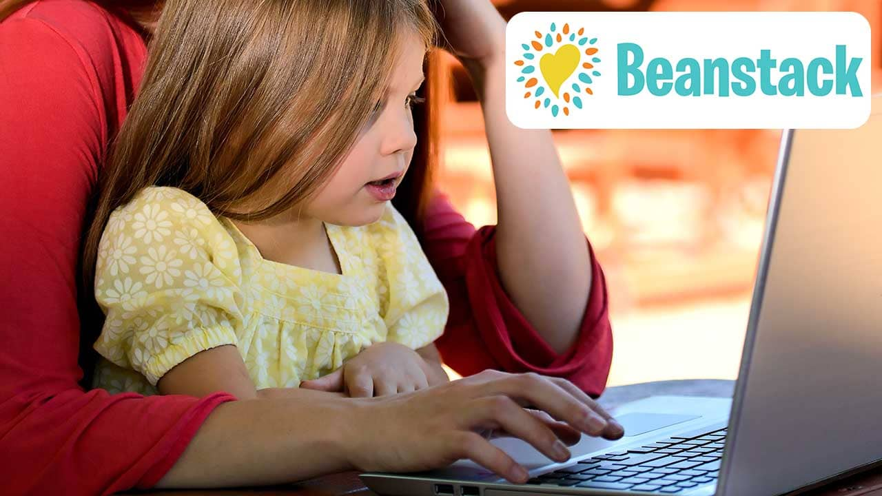 Parent and child using the computer to use Beanstack